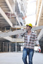 Hard worker on construction site Stock Images