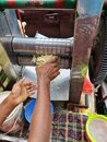 Hard worker hand showing in the time of sugar cane juice processing Royalty Free Stock Photo