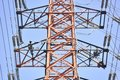 Hard workers do rust treatment on high voltage tower Royalty Free Stock Image