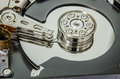 Harddisk inside an internal hard disk show a data record plate and reader Royalty Free Stock Photo