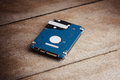 Harddisk storage is storage data for computer slim on wooden table close up connector pin of drive Royalty Free Stock Photos