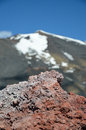 Hardened lava of the mount etna is photographed on blurred background this is an active stratovolcano on east coast sicily Royalty Free Stock Image