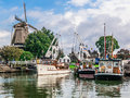 Harderwijk harbor and windmill holland bridge boats in the harbour of netherlands Stock Photos