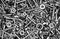 Hardware bolts nuts washers screws an assortment of including Stock Images
