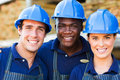 Hardware store workers outside building material warehouse Royalty Free Stock Images