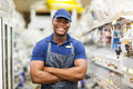 Hardware worker cheerful afro american with arms crossed Royalty Free Stock Image