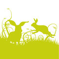Hare and rabbit on the lawn green Stock Images