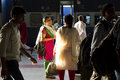 HARIDWAR, INDIA - April 04, 2014 - People at railway station, indian woman in sunlight wearing sari smiling and talking. Royalty Free Stock Photo