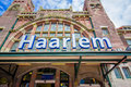 Harlem, Amsterdam, Netherlands - July 14, 2015: Railroad station as seen from outside, beautiful old european style red Royalty Free Stock Photo