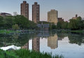 Harlem meer central park new york lake and the reflections of nearby buildings Royalty Free Stock Photo