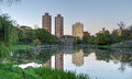Harlem meer central park new york lake and the reflections of nearby buildings Stock Image