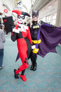 Harlequin and Batgirl at Comic Con Royalty Free Stock Photos