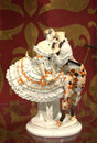 Harlequin and columbine a meissen porcelain figural group of wearing a crinoline her face turned towards harlequins he Royalty Free Stock Image