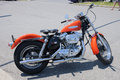 Harley davidson picture of orange motorbike parked in the street Stock Images