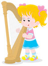 Harpist little girl playing a big harp Royalty Free Stock Image