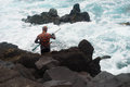 Harpoon spear fisherman at rocky shore Royalty Free Stock Photo