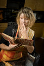 Harried woman with recipe book Royalty Free Stock Photography