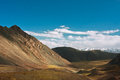 Harsh landscape with mountain range and the deep blue sky Royalty Free Stock Photo
