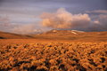 Hart mountain early morning storm clouds loom over the hills at national antelope refuge in eastern oregon under the light Royalty Free Stock Images