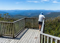 Hartz mountains national park waratah lookout tasmania australia a visitor looks out from in the harts Royalty Free Stock Photos