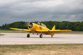 Harvard airplane waterloo ontario june a trainer on the runway on june at the waterloo air show in waterloo ontario canada Royalty Free Stock Photo