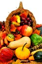 Harvest cornucopia filled with assorted vegetables and fruit Royalty Free Stock Photo