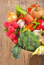 Harvest fresh vegetables on wooden table Stock Photos