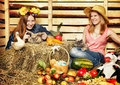 Harvest home two girl with rabbit cat and on hayloft at summer day Royalty Free Stock Photography