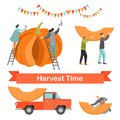 Harvest time. Happy people share a huge ripe pumpkin. Royalty Free Stock Photo