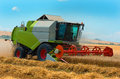 Harvester machine to harvest wheat field working. Agriculture Royalty Free Stock Photo