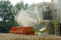Harvesting grain with combine harvester the is harvested a of brand claas lexion type at the harvest a lot of dust and residual Stock Photos