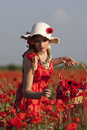 Harvesting poppy young woman in a field Royalty Free Stock Photo