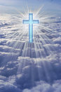 He has risen a cross in heaven surrounded by rays of light Stock Photography