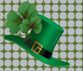 Hat and clover leaves background Royalty Free Stock Images