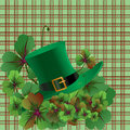 Hat and clover leaves background Stock Photos