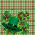 Hat and clover leaves background Royalty Free Stock Photo