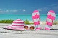 Hat sunglasses and flip flops against ocean exuma bahamas Royalty Free Stock Image