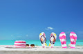 Hat sunglasses and flip flops on the beach of exuma bahamas Royalty Free Stock Photos