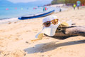 Hat And sunglasses lying on tropical sand beach Sunglasses on the beach. Beautiful sea view wallpaper, background Enjoyed a relaxi Royalty Free Stock Photo
