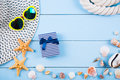 Hat and sunglasses with shells, starfishes, gift box and rope on Royalty Free Stock Photo