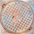Hatch cover in moscow russia on the urban asphalt road closeup photo Royalty Free Stock Photos