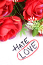 Hate or love beautiful shot of and written on paper with marker Royalty Free Stock Images