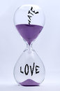 Hate and love hourglass with turning into Stock Photography