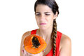 Hate papaya young woman holding a in disgust Royalty Free Stock Photography
