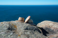 Hats and bag still lifes on rock Royalty Free Stock Photo