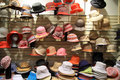 Hats and caps shop ladies gentlemen Royalty Free Stock Images