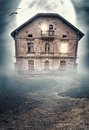 Haunted derelict old house. Halloween design Royalty Free Stock Photo