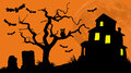 Haunted house hill on a silhouetted by full moon with an owl bats and tombstones in the foreground horizontal format Royalty Free Stock Photo