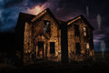 Haunted House with Lightning and Ghosts Royalty Free Stock Photo