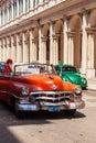 HAVANA, CUBA - APRIL 1, 2012: Taxi driver meets tourist on Orang Royalty Free Stock Photo